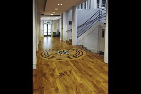 At Bedford Girls' School Archial Architects specified Karndean Designflooring's Van Gogh, Auckland Oak and inlaid a compass-style centrepiece.